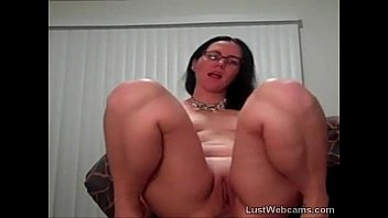 Brunette with glasses masturbates on cam