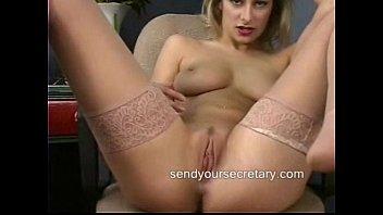 Secretary in stockings masturbatings at her desk