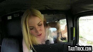 Sexy young blonde babe gets fucked hard in a taxi