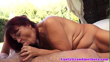 sandy-haired grannie doggystyled outdoors