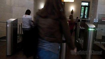 upskirt of a slender woman on an escalator.