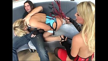 Threesome in latex corsets stockings and gloves