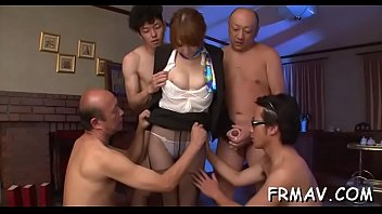 Oriental babe toys her pussy before giving randy irrumation