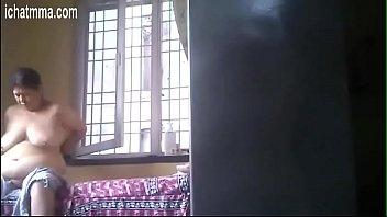 0364707459 Desi granny rubs lotion after bath