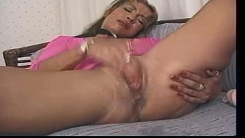 Jasmine solo in the couch masturbating with a big toy and squirting