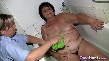 nurse is bathing bare grandma