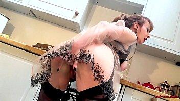 mature redheaded vixen stimulates her slit in the kitchen
