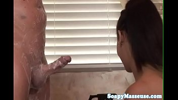 Busty asian masseuse tribbing on a hard dick