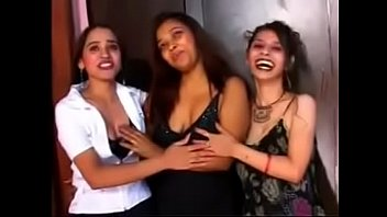 indian school ladies have fun with poon in.