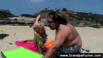 older freak entices beach lady