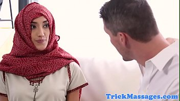 Hijab wearing massage client blows masseur