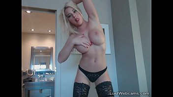 Hot blonde with big tits toys herself on cam