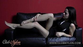 Brunette Tiff Naylor teasing her nylon pantyhose legs and feet