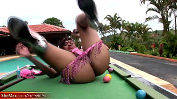 total flick of she-creature inserting pool ball in.