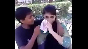 indian teenie smooching and pressing hooters.