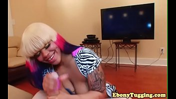Tattooed ebony babe tugging on fat cock