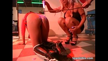 Sexy blonde spanks other slut