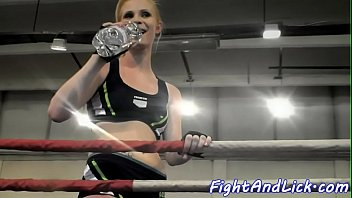 Muscular women wrestling in a boxing ring