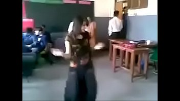 pakistani female dance in front of studs in classroom