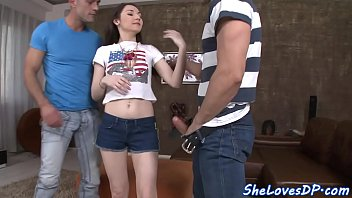 Double penetrated teen babe gets facialized