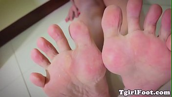 footworship tgirl demonstrating feet in macro.