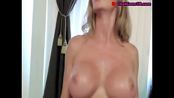 blond cougar showcases off pec muscles on web cam