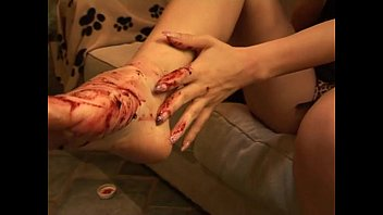 domme opens up crimson wedge on her feet.