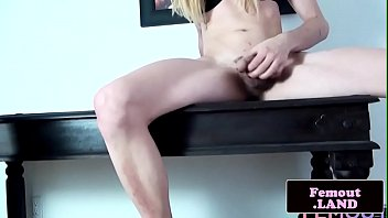Tattooed tranny jerking her boner