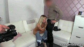 Hot blonde babe sucking on her agents hard cock