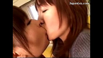 japanese lady smooching intensively getting her breasts groped.