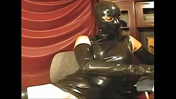 woman in spandex cock-squashing sundress and mask on.