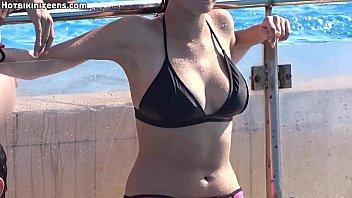 stunning bathing suit sans bra pool.