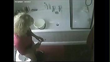 covert webcam caught my mega-bitch mommy tugging in wc