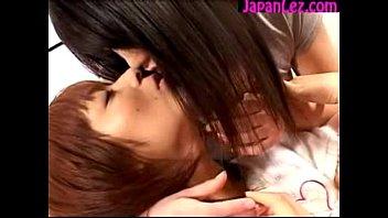 2 nice japanese femmes smooching energetically